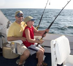 Father and son fishing in a Key West FL charter boat